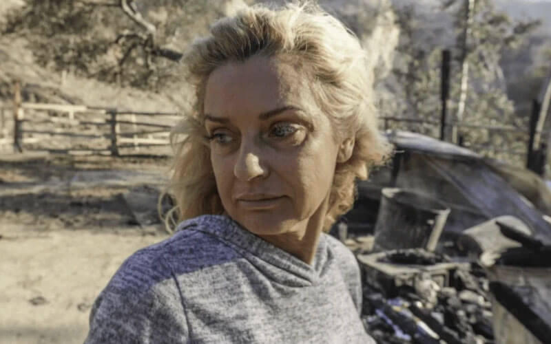 sad woman looking at fire damage